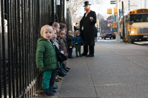 Privatized Satmar pre-school Rabbi and his students. Photo Credit: Mark Hanover