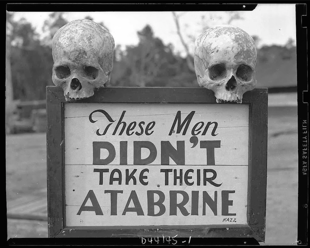 A sign posted at the 363rd Station Hospital in Papua New Guinea during World War II admonishes soldiers to take their antimalarials